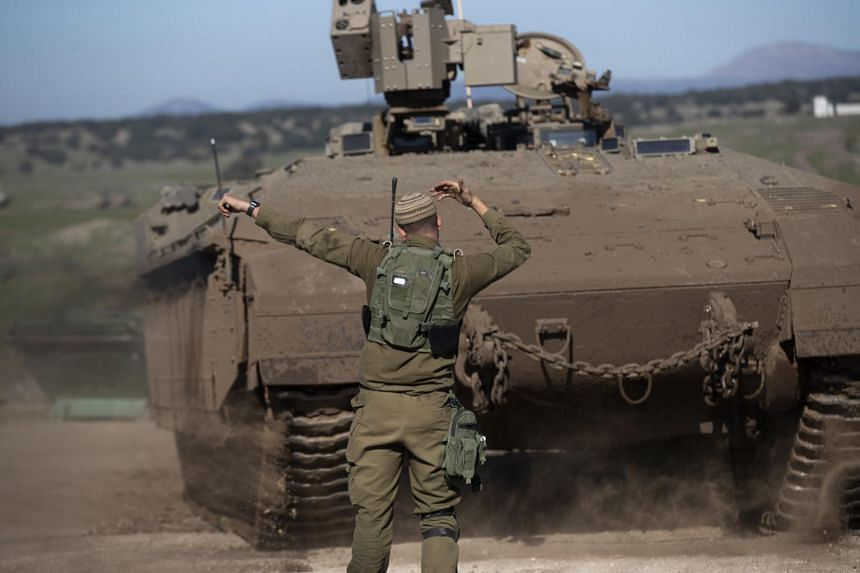 An Israeli armoured personnel carrier during a military drill in the Israeli-annexed Golan Heights on Dec 30, 2020.