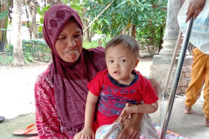 Ms Eva Murni and 3-year-old Muhammad Rahman who suffers from stunting. After years of progress curbing the scourge, Indonesia faces a resurgence due to Covid-19.