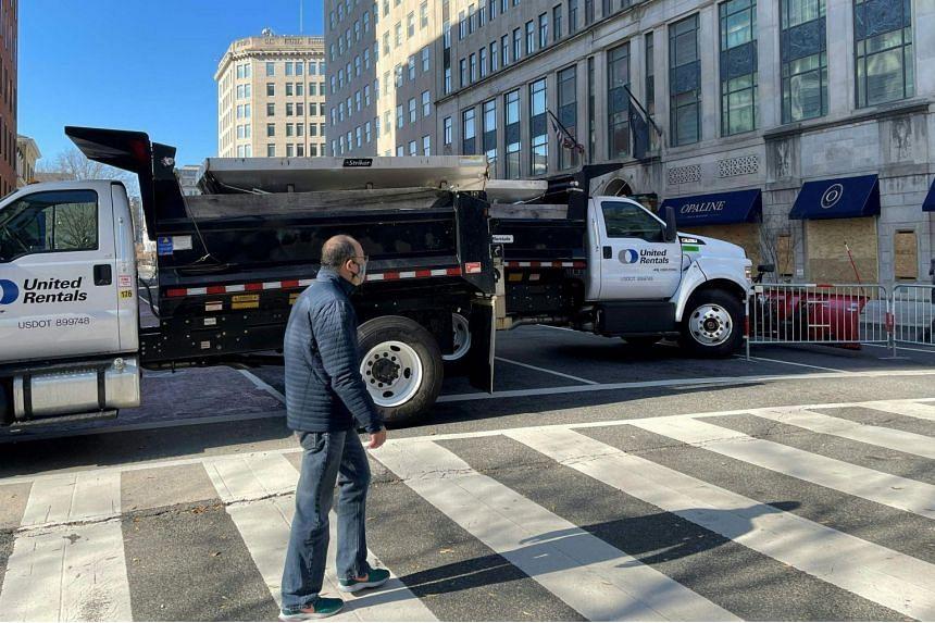 Trucks block streets next to the White House in Washington DC, on Jan 12, 2021.
