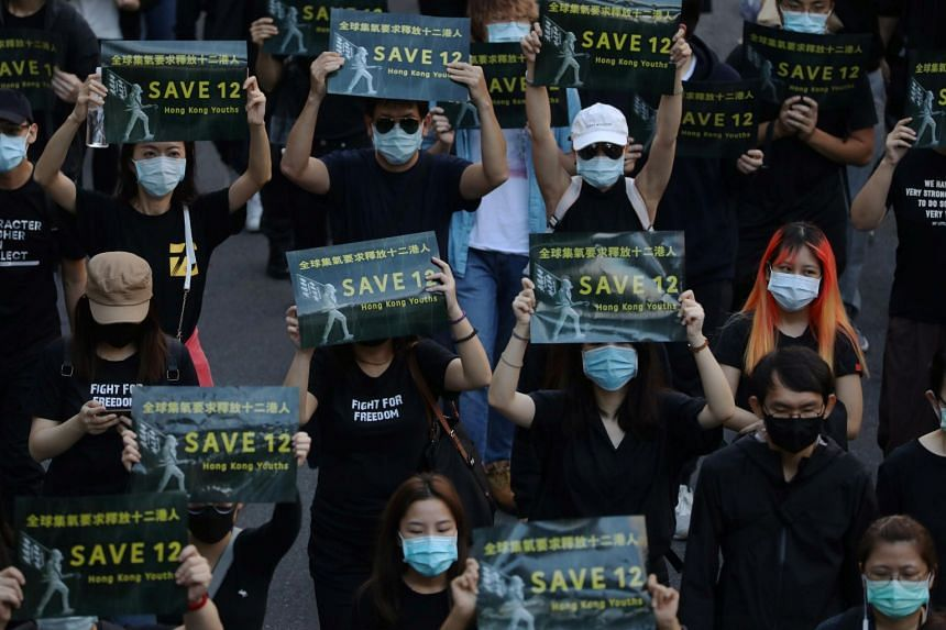 Protesters attend a rally calling China to release 12 Hong Kong people arrested at sea by the mainland authorities, in Taipei, on Oct 25, 2020.