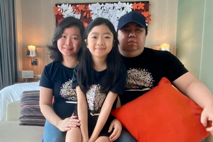 Ms Joan Sim, Mr Anthony Chng and their daughter Chng Rui Jie, who raised over $56,000 for The Straits Times School Pocket Money Fund.