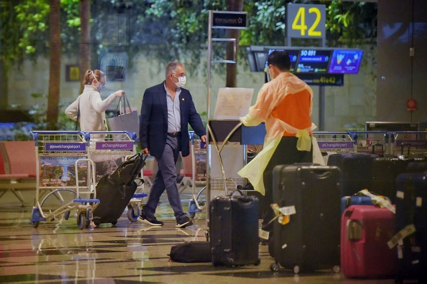 Passengers arriving at Changi airport in December 2020.
