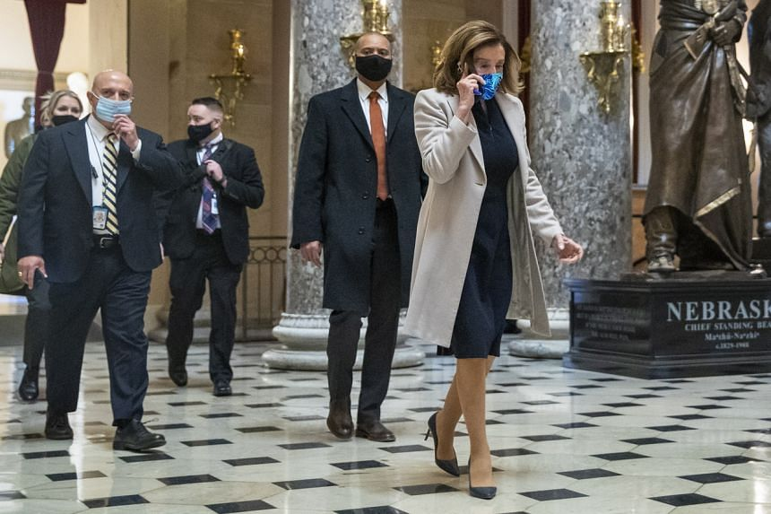 Speaker of the House Nancy Pelosi walks through Statuary Hall to her office following her arrival at the US Capitol in Washington on Jan 13, 2021.