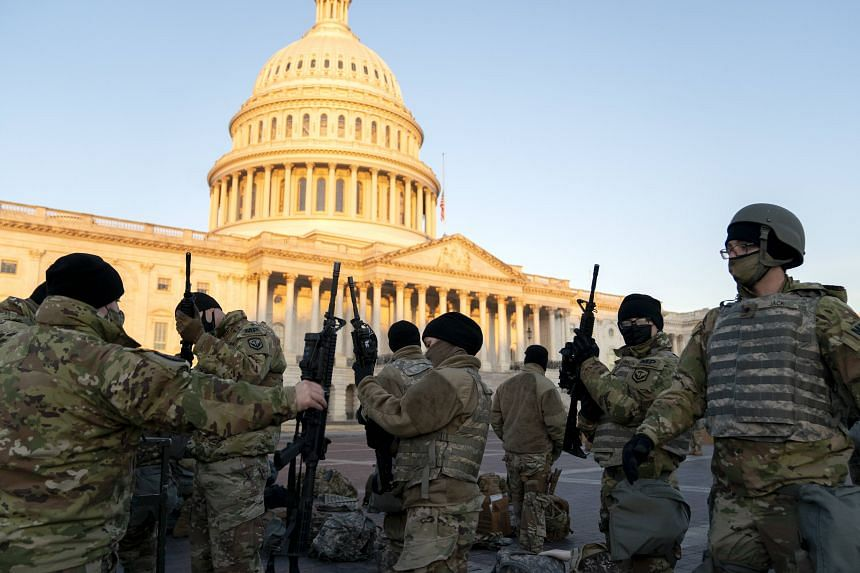 Weapons are distributed to members of the National Guard outside the US Capitol in Washington on Jan 13, 2021.