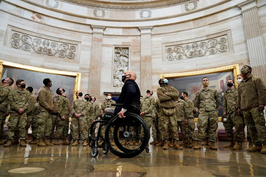 US Rep. Brian Mast leads a tour for members of the National Guard at the US Capitol in Washington on Jan 13, 2021.