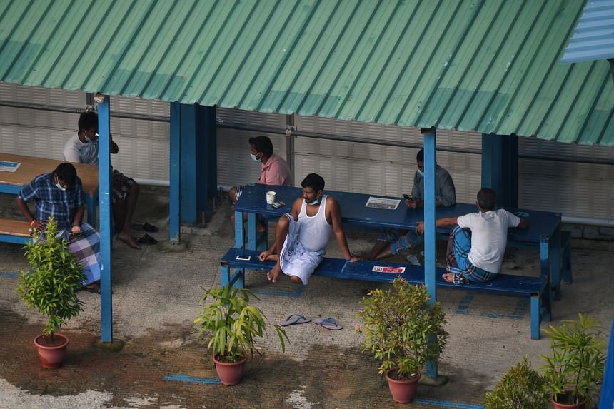 Foreign workers resting in an on-site dormitory on June 1, 2020.