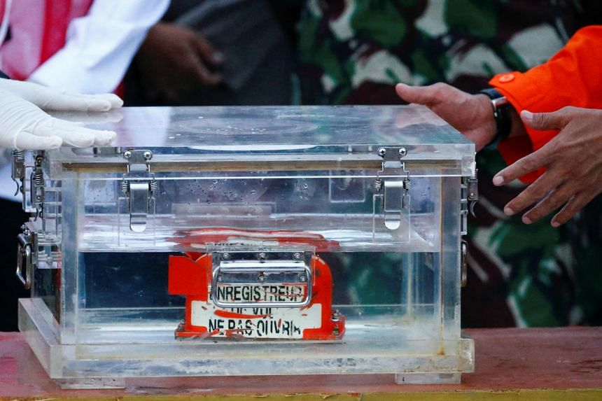 Divers found the first black box - the flight data recorder - by shifting debris on the seabed piece by piece.