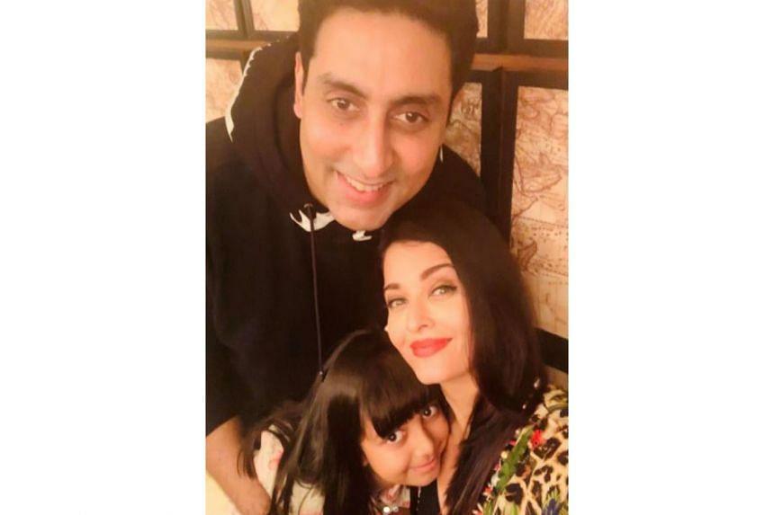 Aishwarya Rai Bachchan and Abhishek Bachchan with their daughter