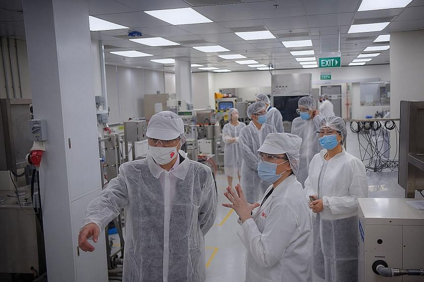 Trade and Industry Minister Chan Chun Sing (far left), with Ms Xue Si-Ying (centre), DuPont Nutrition & Biosciences' innovation leader for Asean, on a tour of DuPont's Dairy and Beverage Lab in Buona Vista yesterday. Mr Chan said Singapore is happy t