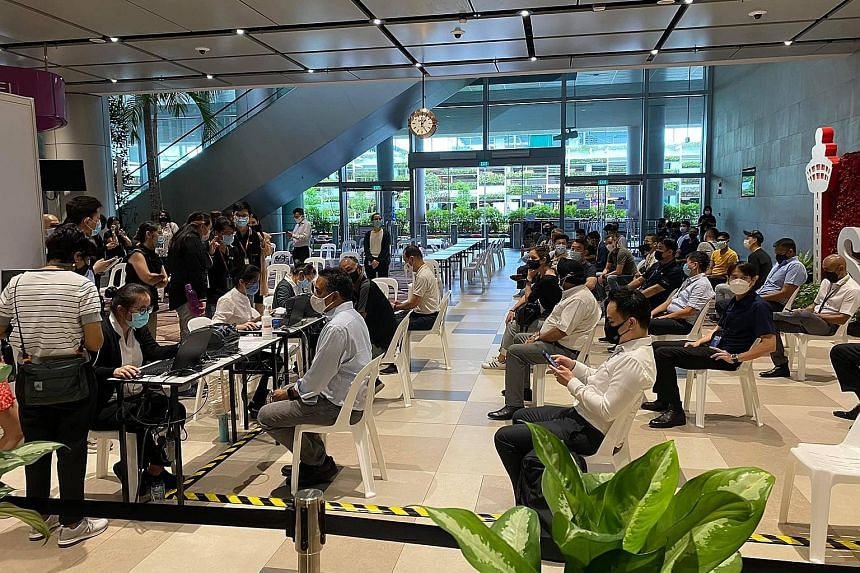 The first group of front-line airport workers getting their Covid-19 vaccine injections at Changi Airport Terminal 4 yesterday.