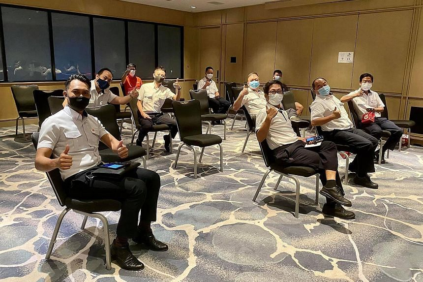 Harbour pilots from PSA took their vaccinations at Raffles City Convention Centre yesterday afternoon. The SafeEntry@Sea platform will be introduced at piers, such as Marina South Pier and West Coast Pier.