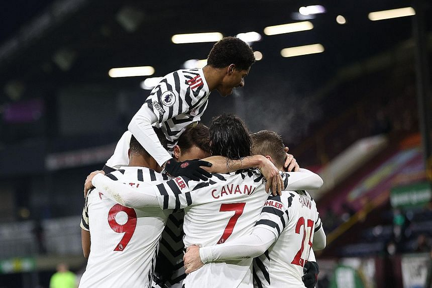 United midfielder Paul Pogba being mobbed by teammates after scoring the winner in Tuesday's league match at Burnley.