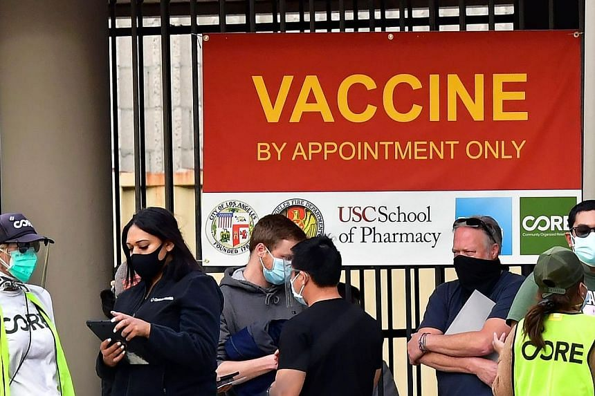People queueing up outside a Covid-19 vaccination facility in Los Angeles, California, on Tuesday. As at Monday night, the United States had reported a total of 22.5 million coronavirus infections and 376,188 deaths, the most in any country. PHOTO: A