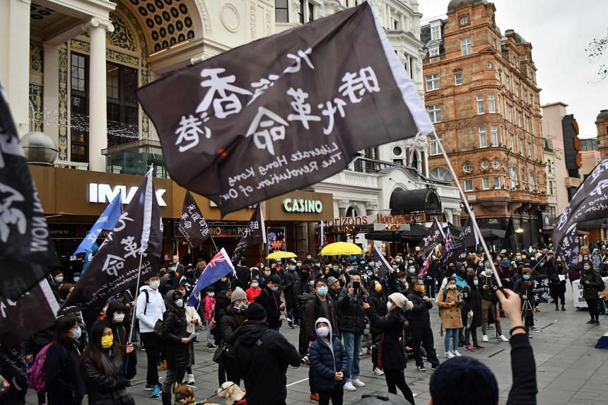 Protesters gather at an event organised by Justitia Hong Kong in Leicester Square, central London, on Dec 12, 2020.