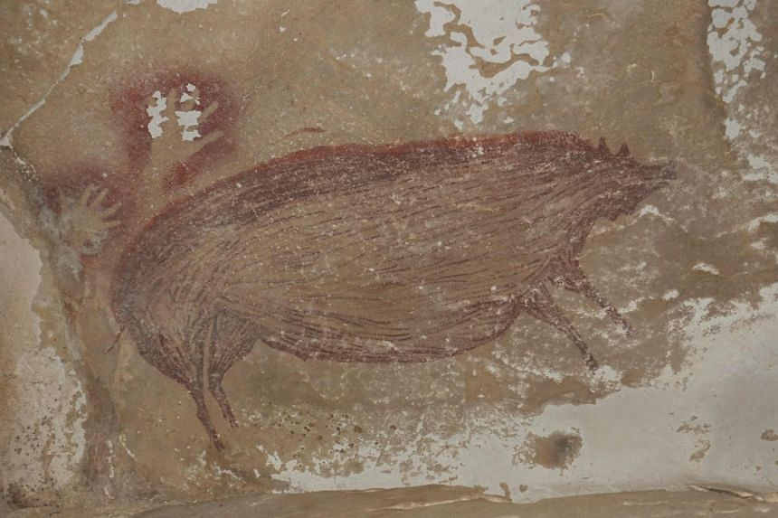 A handout photo shows the pig painting found in a cave in Sulawesi, Indonesia.