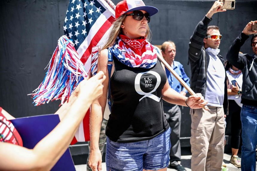 A QAnon supporter at a rally in San Diego, California, in May last year. The FBI considers the loosely connected, cult-like, rambling network of conspiracy theories a domestic terrorism threat.