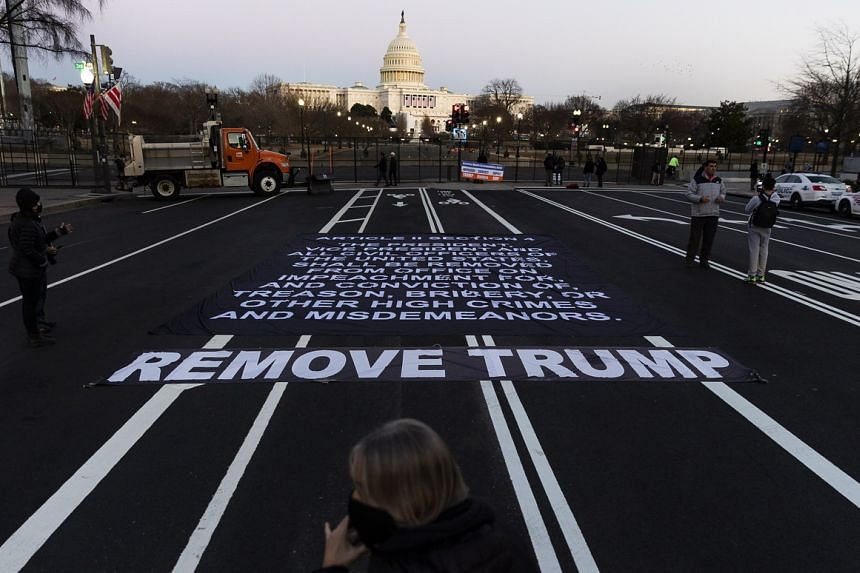 A large banner with the impeachment clause of the US constitution is seen near the US Capitol on Jan 13, 2021.