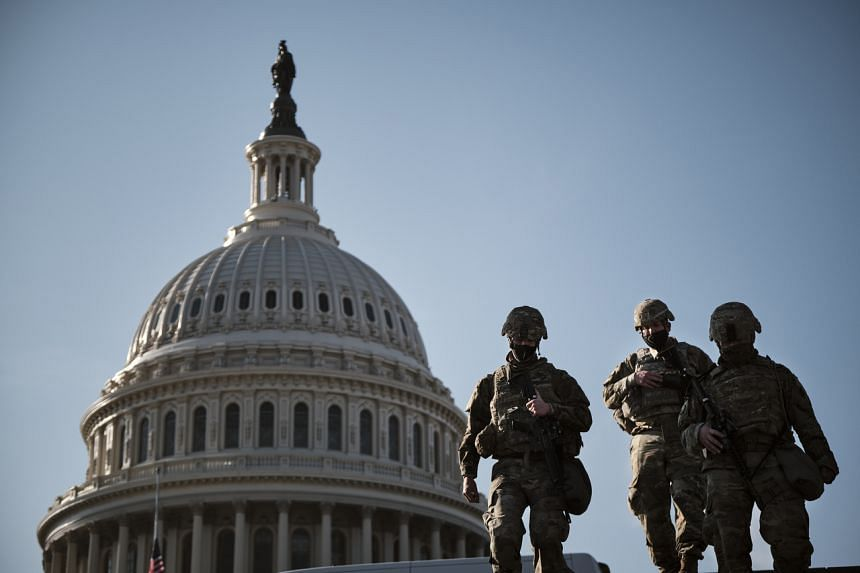 Armed National Guard troops at the US Capitol in Washington on Wednesday afternoon, Jan 13, 2021.