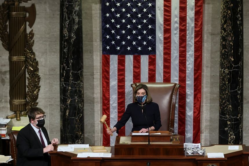US House Speaker Nancy Pelosi presides over the vote to impeach President Donald Trump in the Capitol in Washington on Jan 13, 2021.