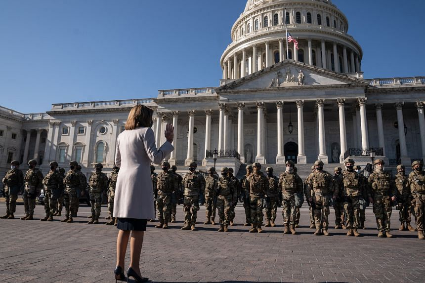 US Speaker of the House Nancy Pelosi meets with National Guard troops outside the Capitol in Washington on Jan 13, 2021.