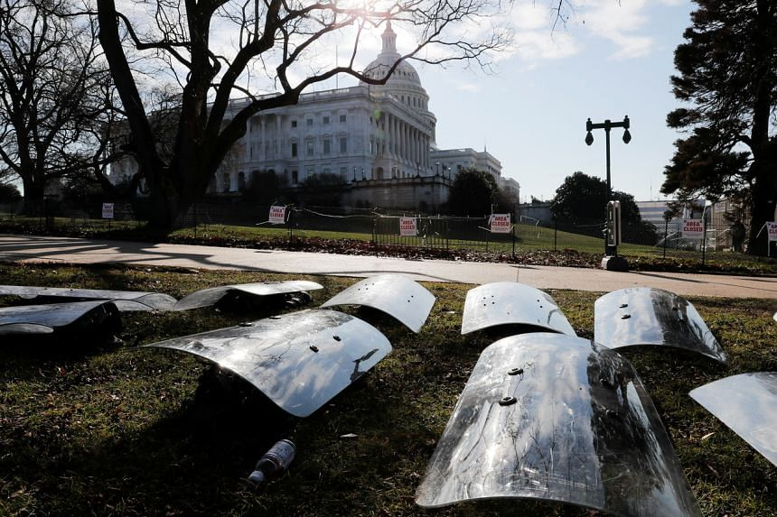 US National Guard riot shields are laid out at the ready outside the Capitol on Jan 13, 2021.