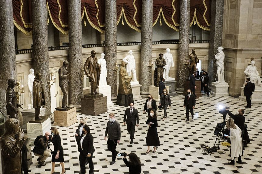 The House impeachment managers walk through Statuary Hall following the vote to impeach US President Donald Trump at the Capitol in Washington on Jan 13, 2021.