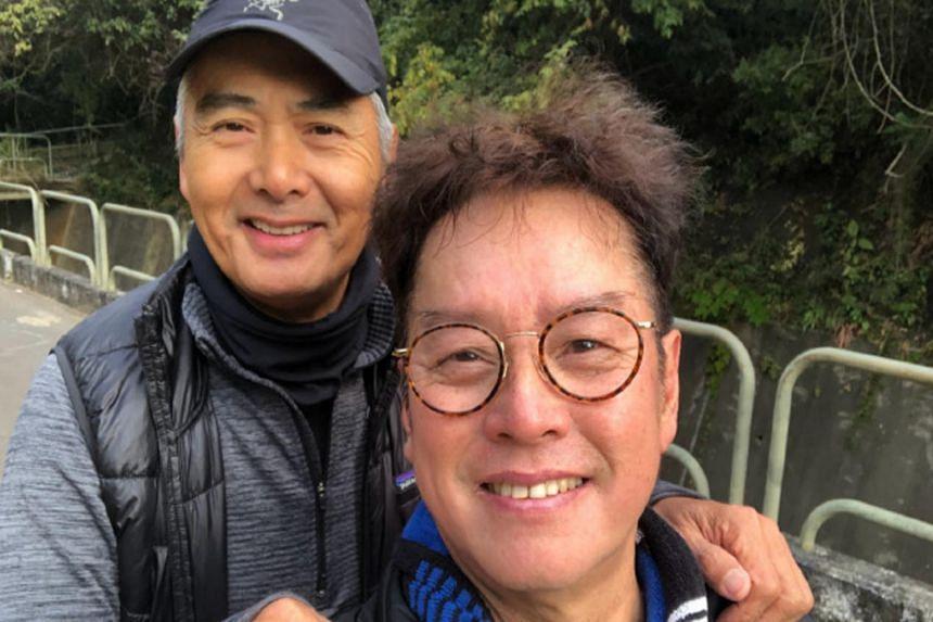 Hong Kong singer Alan Tam (right) with Hong Kong actor Chow Yun Fat.
