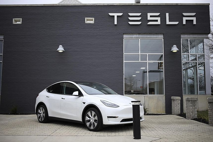 """A Tesla Model S electric vehicle for sale outside a dealership in Ohio. The United States National Highway Traffic Safety Administration says it has tentatively concluded that the 2012-2018 Model S and 2016-2018 Model X vehicles """"contain a defect rel"""