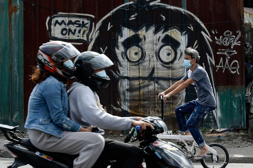 A mural reminding people to wear their masks in Caloocan City, Philippines. The country has tallied at least 494,000 cases of Covid-19. PHOTO: REUTERS