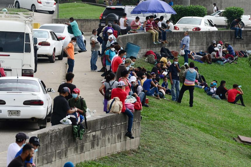 People waiting for the start of the first migrant caravan of the year to the US in San Pedro Sula Honduras on Jan 14 2021