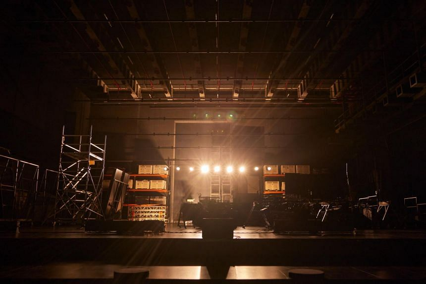 The audience is invited to sit on the theatre's empty stage and bask in the quiet magnificence of its architecture.