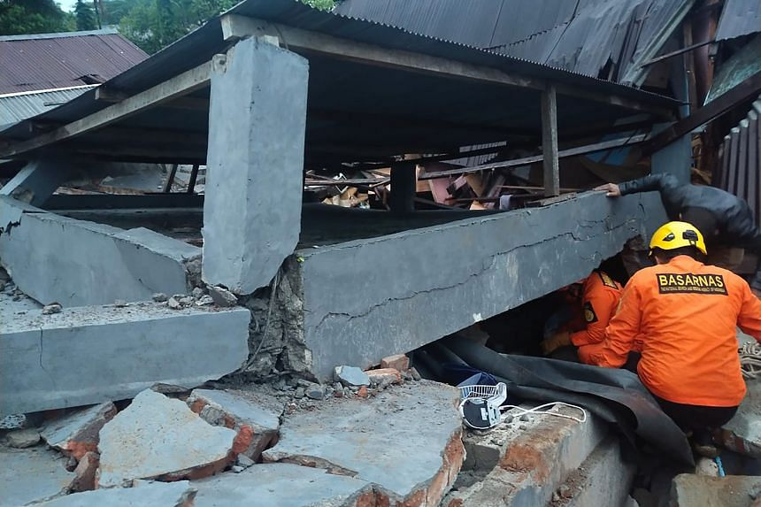 Rescuers looking for survivors trapped in a collapsed building in Mamuju, after a 6.2-magnitude earthquake rocked Sulawesi island, on Jan 15, 2021.
