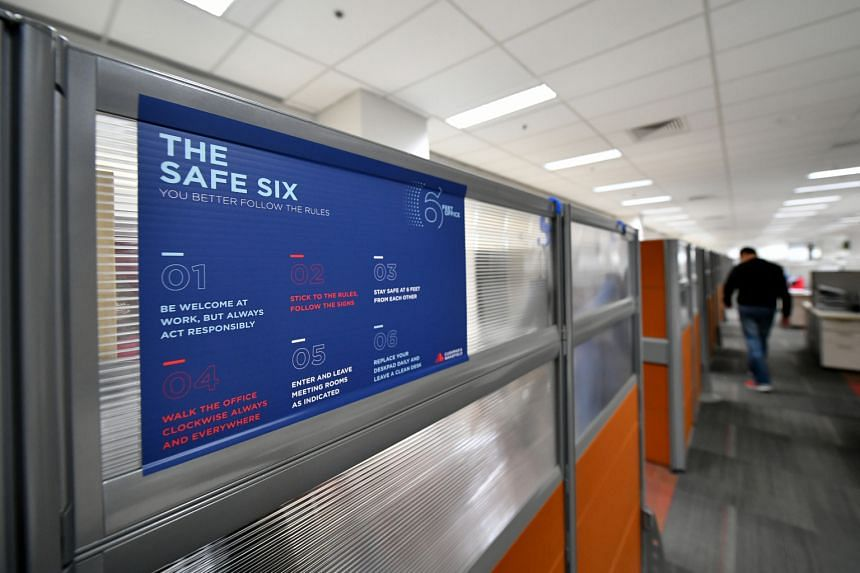 """""""The safe six"""" posters, which state the rules to follow, are pasted everywhere around the office of C&W Services, the facilities and engineering arm of commercial real estate services firm Cushman & Wakefield."""
