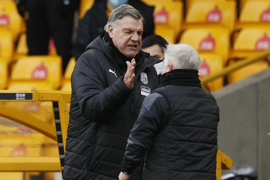 Sam Allardyce and Sammy Lee celebrate after the match against Wolverhampton Wanderers in Britain on Jan 16, 2021.