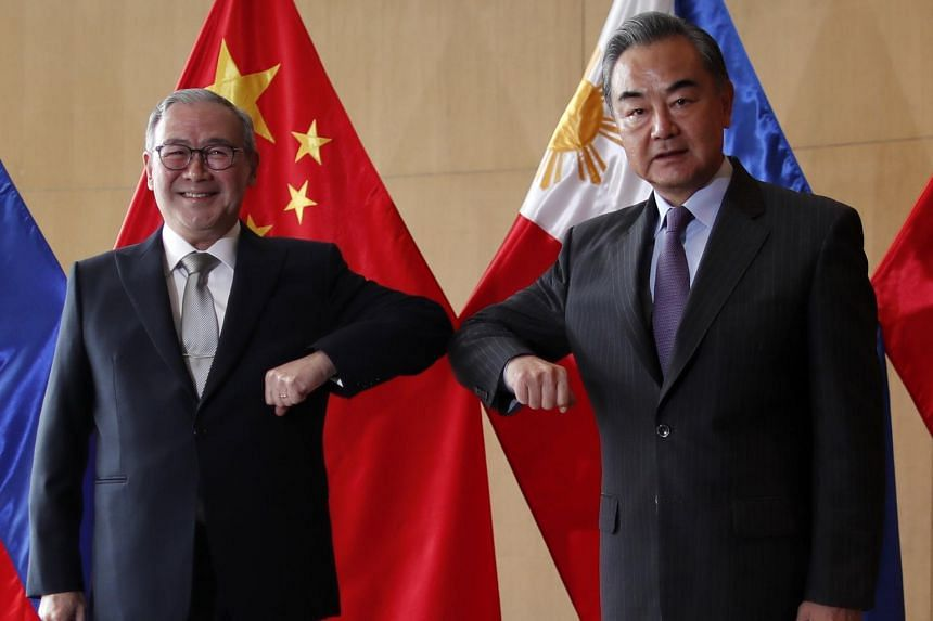 Philippine Foreign Affairs secretary Teodoro Locsin (left) and Chinese Foreign Minister Wang Yi committed to prioritising post-pandemic recovery efforts.