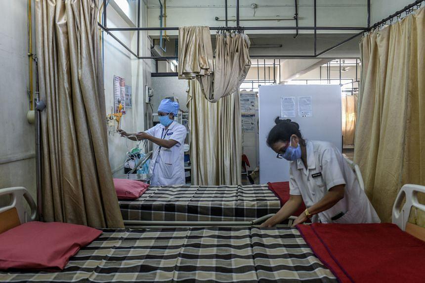 Nurses prepare a vaccination centre in Pune, India, on Jan 15, 2021.