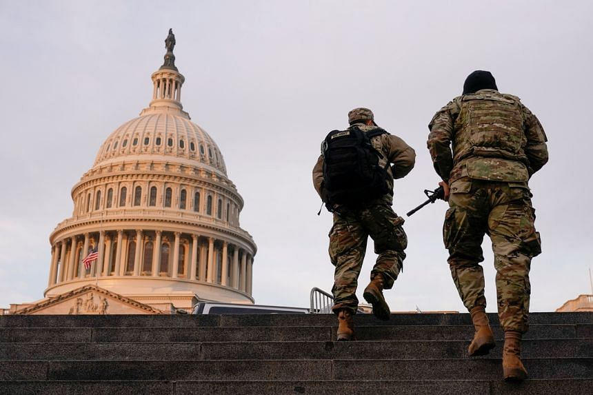 Armed National Guard members at the Capitol in Washington, on Jan 15, 2021.