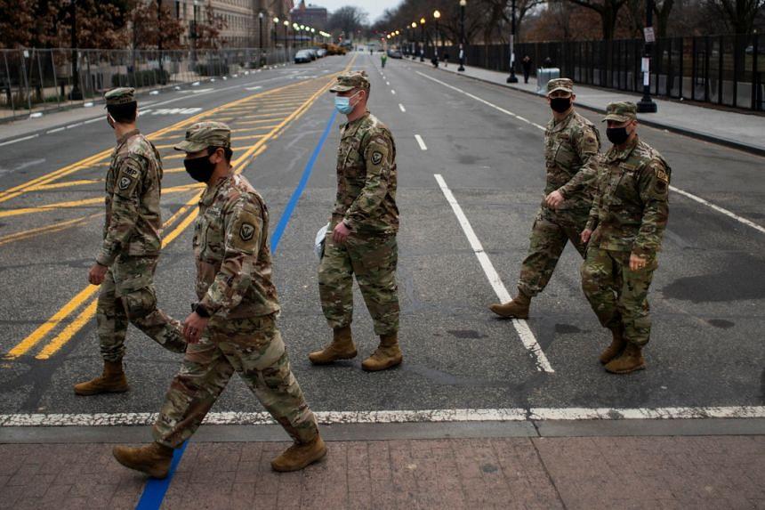 Members of the National Guard walk near the White House ahead of US President-elect Joe Biden's inauguration, on Jan 15, 2021.