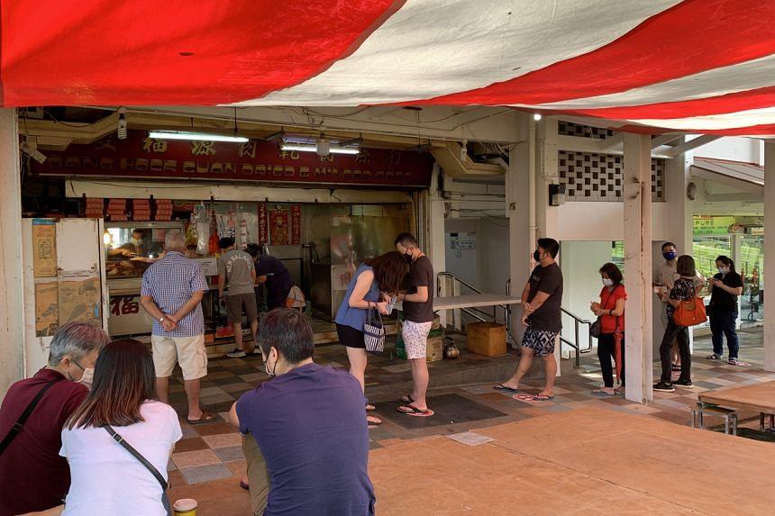 Customers queueing at bak kwa stall Sang Hock Guan in Ang Mo Kio on Jan 16, 2021.