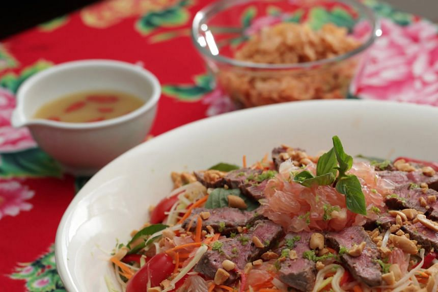 The beef lohei is a mash-up of a beef larb, a salad made with ground beef; and som tum, a green papaya salad.