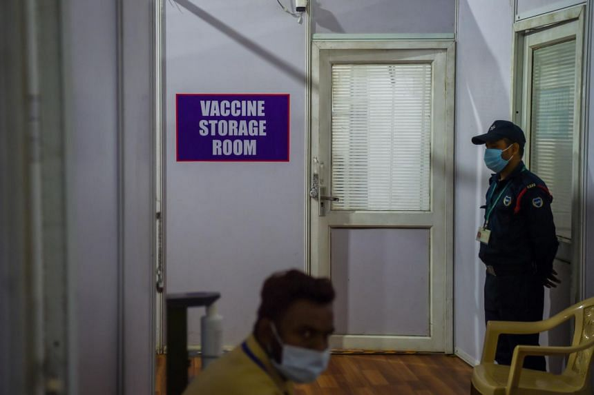 A security officer stands guard outside a Covid-19 vaccine storage room in a centre in Mumbai, on Jan 15, 2021.