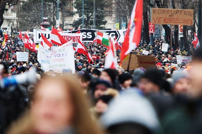 Demonstrators march during a protest against coronavirus restrictions in Vienna on Jan 16, 2021,