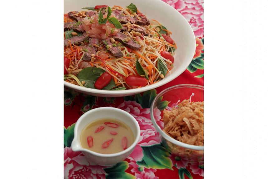 Beef lohei that is a mash-up of a beef larb, a salad made with ground beef; and a som tum, a green papaya salad.