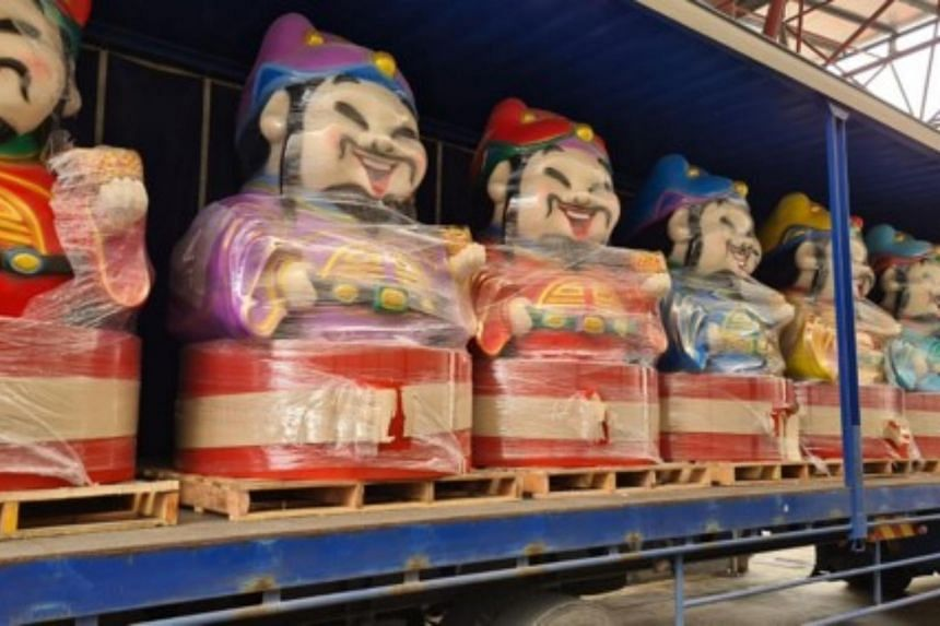 Officers discovered a total of 11,285 cartons and 7,685 packets of duty-unpaid cigarettes found hidden inside the figurines.