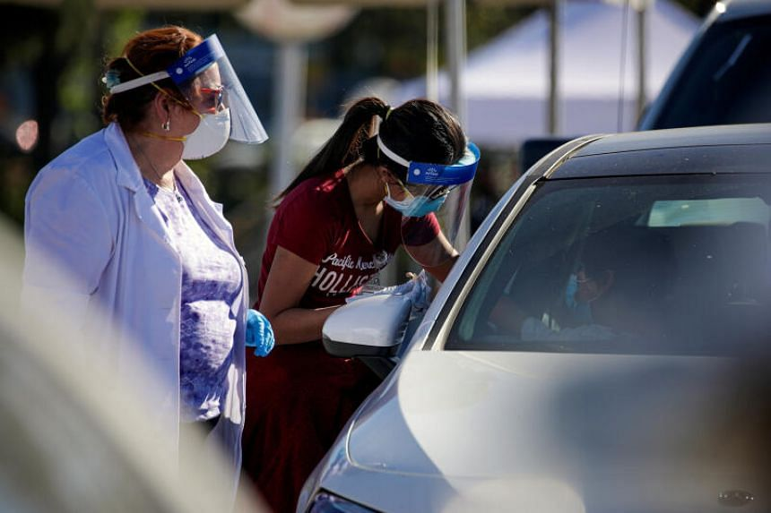 A mass-vaccination programme for healthcare workers being conducted at Dodger Stadium in Los Angeles on Jan 15, 2021.