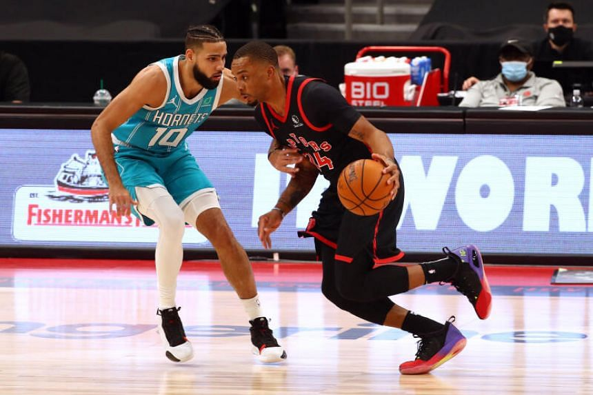 Toronto Raptors Norman Powell driving to the basket against Charlotte Hornets Caleb Martin (left) during their NBA match on Jan 16, 2020.