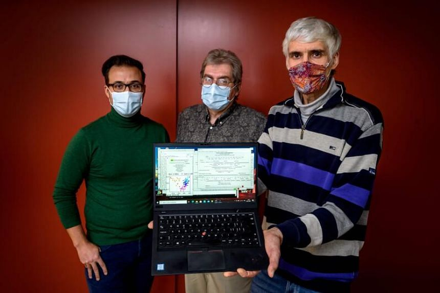 OrphAnalytics CEO Claude Alain Roten with staff members and a laptop using the text analysis software on Jan 6, 2021.