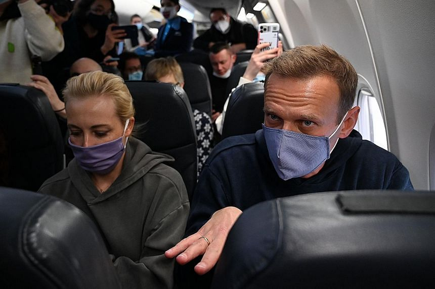 Russian opposition leader Alexei Navalny and his wife Yulia on a plane at Berlin Brandenburg Airport before take-off yesterday. They were returning to Russia after he spent five months in Germany recovering from a poisoning attack. PHOTO: AGENCE FRAN