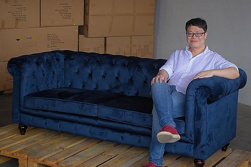 Mr Ryan Wong at BedandBasics' warehouse in Jurong East. The online furniture store grew amid the pandemic, with sales tripling in November last year compared with the same month in 2019.