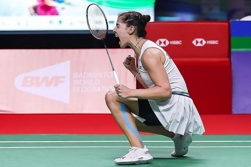 Left: Spain's Carolina Marin screams in delight after beating Chinese Taipei's Tai Tzu-ying 21-9, 21-16 in the women's singles final at the Yonex Thailand Open in Bangkok. Above: Denmark shuttler Viktor Axelsen raises his arms in celebration after de